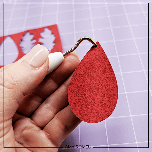 punching holes in faux suede earring shapes